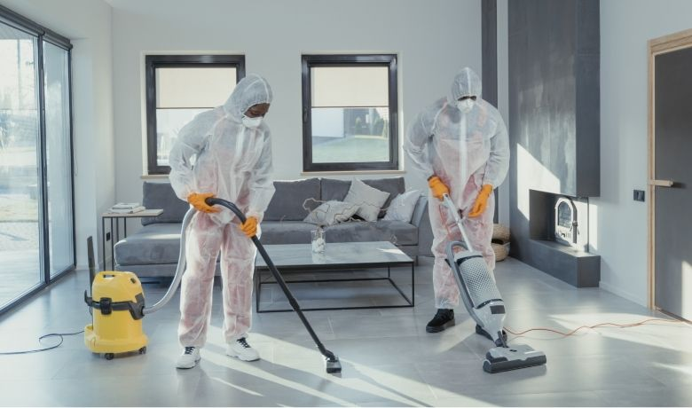 two people using upright and Cylinder vacuums